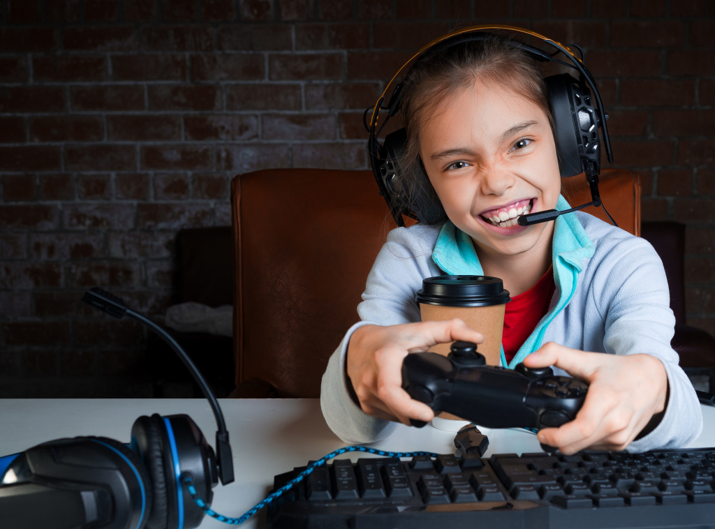 young-girl-big-headphones-with-microphone-is-sitting-front-monitor-playing-video-games-with-happy-excited-face-win.jpg